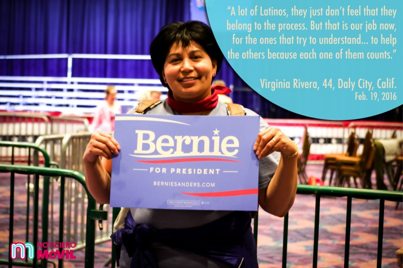 Foto de una mujer sosteniendo un cartel de Bernie Sander.